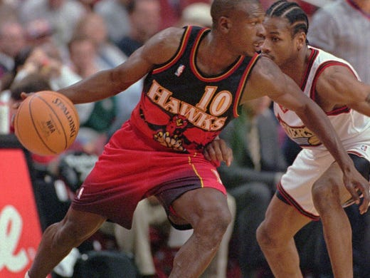 Blaylock tries to dribble around Allen Iverson in 1997.