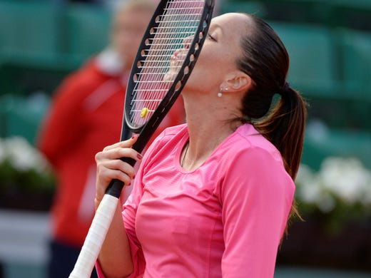 Jelena Jankovic gives her racket a smooch after defeating Samantha Stosur 3-6, 6-3, 6-4.