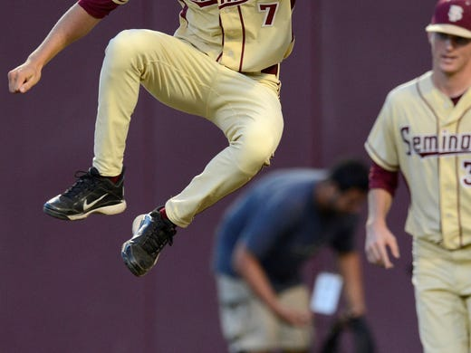 Florida State Seminoles pitcher Luke Weaver (7) celebrates their 11-4 victory over the Troy Trojans during the Tallahassee regional of the 2013 NCAA baseball tournament at Dick Howser Stadium. Weaver was named tournament MVP.