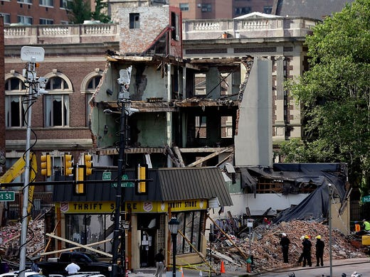 Firefighters view the the wreckage at the scene of a building collapse on June 6 in Philadelphia. Six people were killed when building being demolished collapsed onto a neighboring thrift store on June 5.