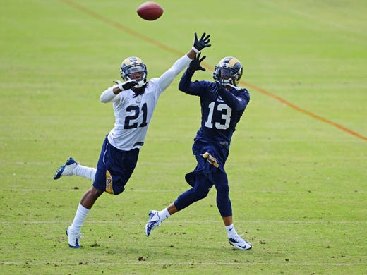 St. Louis Rams cornerback Janoris Jenkins (21) defends against wide receiver Chris Givens (13) during organized team activities at ContinuityX Training Center.