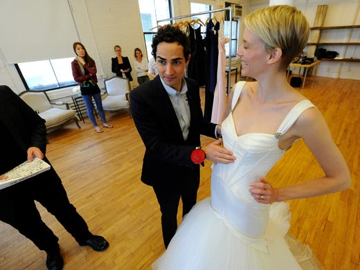 Designer Zac Posen works with model (and designer) Betina Holte on one of his bridal designs. USA TODAY's Olivia Barker and Robert Deutsch  shadowed Posen as he met with David's Bridal about designing his new bridal line, Truly Zac Posen, for the company.