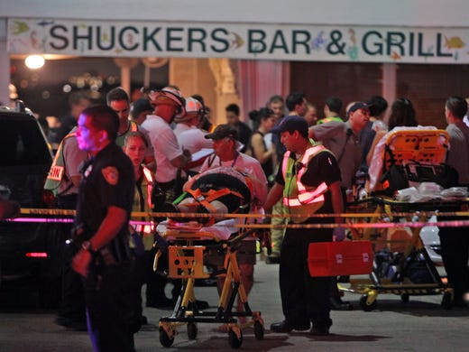 Rescuers transport an injured patron after the outdoor deck at Shuckers Bar and Restaurant in Miami collapsed during Game 4 of the NBA Finals. Police said 24 people were injured and two were in serious condition.