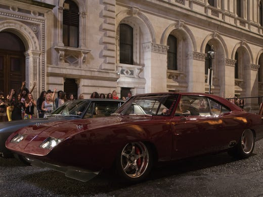 Vin Diesel drives a Dodge in a scene from the motion picture 'Fast , Furious 6.'
