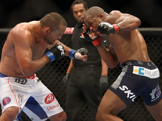 Rashad Evans (right) fights Dan Henderson during their light heavyweight bout at UFC 161 at MTS Centre.