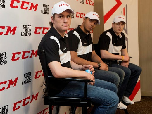 Jonathan Drouin, left, Seth Jones, center, and Nathan MacKinnon will go early in Sunday's NHL draft. USA TODAY hockey columnist Kevin Allen offers his mock draft: