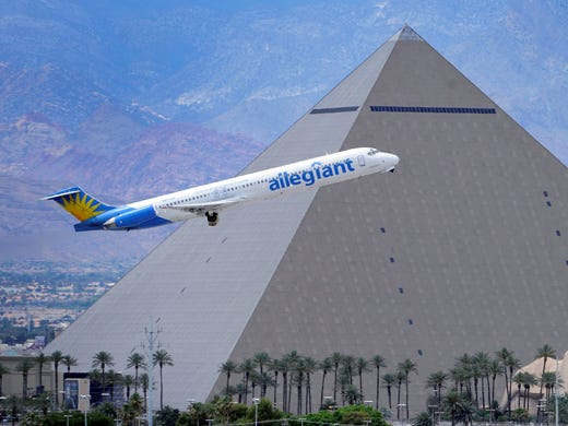 An Allegiant Air jet flies past the Luxor Resort & Casino after taking off from McCarran International Airport in Las Vegas on May 9, 2013. While other U.S. airlines have struggled with the ups and downs of the economy and oil prices, tiny Allegiant Air has been profitable for 10 straight years.