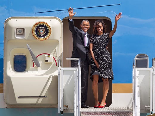 President Obama and first lady Michelle Obama board Air Force One as they prepare to leave Africa at Julius Nyerere airport in Dar es Salaam, Tanzania. During his one-week trip, the president courted African business leaders and announced new trade initiatives to open up East Africa's markets to American businesses, as he sought to counter the rise of Chinese economic influence on the continent.