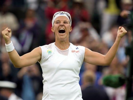 Kirsten Flipkens celebrates match point against Petra Kvitova.