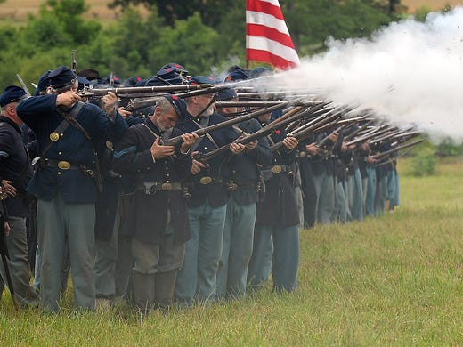Civil War re-enactors of the National Regiment fire their rifles during the 150th anniversary commemorating Pickett's Charge at Gettysburg National Military Park on July 3 at Gettysburg, Pa. On July 3, 1863, Confederate Gen. Robert E. Lee attacked Union forces on Cemetery Ridge with troops led by Gen. George E. Pickett. The attack failed, ending the three-day Civil War battle at Gettysburg.