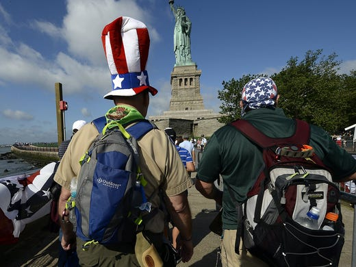 Tourists arrive at the Statue of Liberty on July 4 in New York City. The iconic statue reopened for the first time since Hurricane Sandy caused extensive damage to docks, paths and buildings around Lady Liberty.