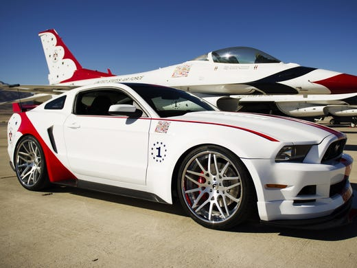 The engineering and design teams at Ford Ford has produced a unique U.S. Air Force Thunderbirds Edition of the 2014 Ford Mustang GT to be sold for charity. Here it is with the team's F-16s