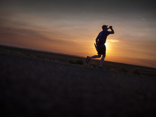 Several individuals are traveling across America to raise money for a cause this summer. Will Allender of Fort Collins, Colo.,  makes his way across the quiet landscape of New Mexico near Pueblo Pintado as he takes part  in the One Run for Boston relay.