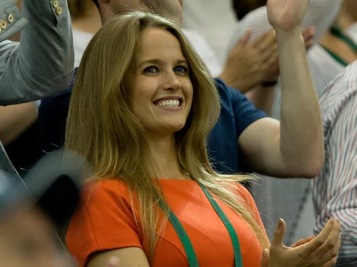 Kim Sears girlfriend of Andy Murray watches as he celebrates winning his semifinal match against Jerzy Janowicz.