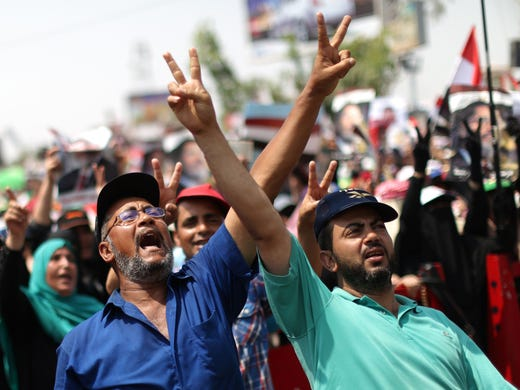 Egyptian supporters of deposed president Mohammed Morsi shout slogans during a rally in support of the former Islamist leader outside Cairo's Rabaa al-Adawiya mosque on July 9.