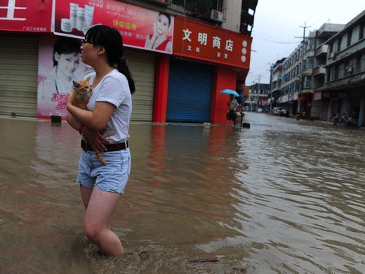 Flooding in western China, the worst in 50 years for some areas, has triggered a landslide that buried up to 40 people and destroyed a high-profile memorial to a devastating 2008 earthquake.