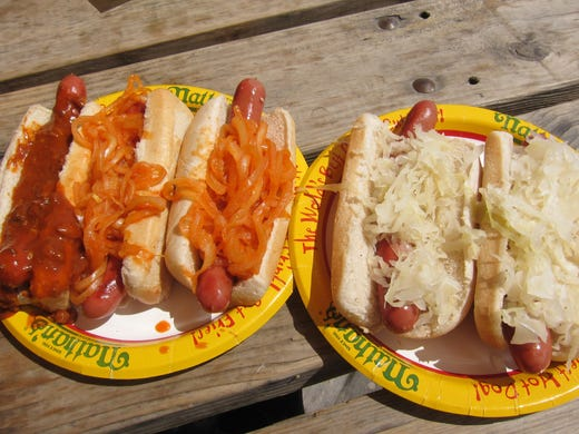The most famous hot dogs in America are the heart and soul of Nathan's Famous. From far left: chili dog; two with New York-style grilled red onions; two with sauerkraut.