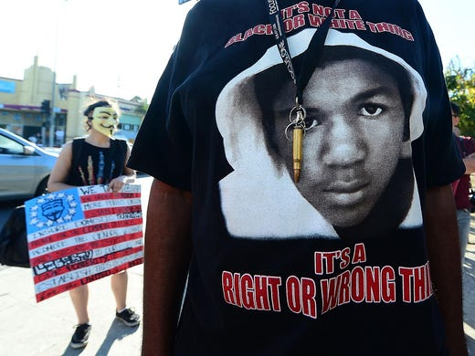 A man wears a bullet around his neck during a Los Angeles rally on July 15 after George Zimmerman's acquittal in the shooting death of Florida teen Trayvon Martin.