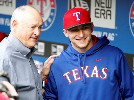 Texas Rangers CEO Nolan Ryan (left) poses for a picture with Johnny Manziel (right) beforea game against the Angels.