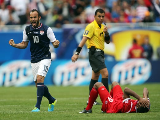 USA player Landon Donovan celebrates as Panama player Alberto Quintero lies on the ground after the 2013 Gold Cup championship game at Soldier Field.