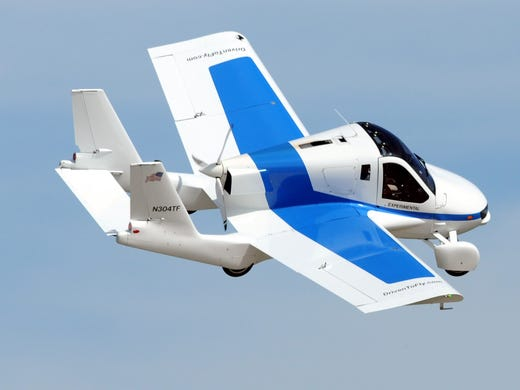 """The Terrafugia """"roadable plane"""" banks during the Experimental Aircraft Association's AirVenture in Oshkosh, Wis."""