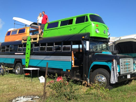Sherri and Donny Rector atop their bus at EAA AirVenture in Oshkosh, Wis.