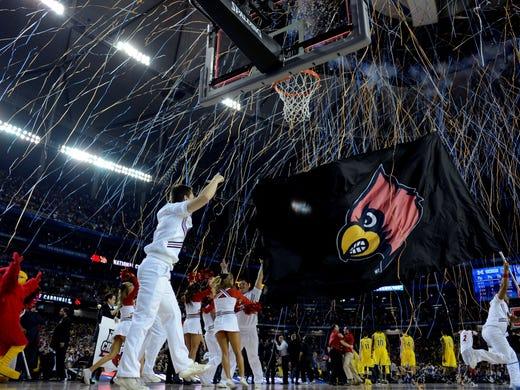 Louisville cheerleaders celebrate the Cardinals winning the national championship.