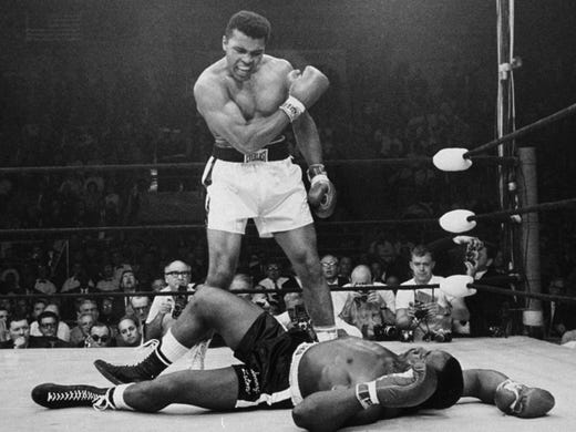 Muhammad Ali stands over fallen challenger Sonny Liston, shouting and gesturing shortly after dropping Liston with a short hard right to the jaw on May 25, 1965.