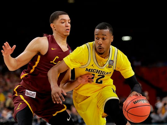 Michigan guard Muhammad-Ali Abdur-Rahkman drives past Loyola-Chicago guard Lucas Williamson, left, during the first half in the semifinals of the Final Four NCAA college basketball tournament, Saturday, March 31, 2018, in San Antonio. (AP Photo/Eric Gay)