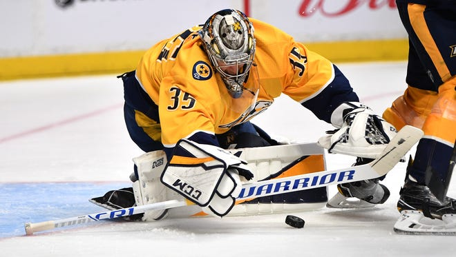 Predators goalie Pekka Rinne (35) stops a shot during the second period in game 2 of the first round NHL Stanley Cup Playoffs at Bridgestone Arena Saturday, April 14, 2018, in Nashville, Tenn.