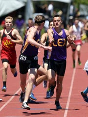 Lexington's Mason Kearns hands he baton to Ryan Johnston during the  DII 4x800 relay. The Minutemen finished second.