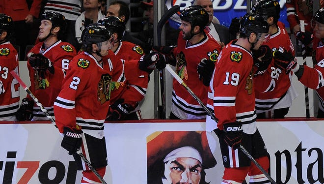 Chicago Blackhawks center Jonathan Toews, right, and defenseman Duncan Keith celebrate the captain's first-period goal.