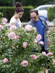 From the archive: Sara Giambraand her dad Michael Giambra at the annual Maplewood Rose Garden festival in 2009.