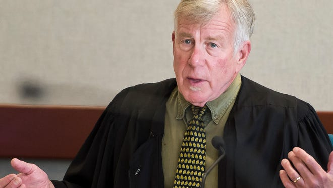 During a hearing Friday in Vermont Superior court in Burlington, Judge Michael Kupersmith questions the state's inquest subpoena to obtain letters that attempted-murder suspect James Scarola sent to the Burlington Free Press regarding his his case.