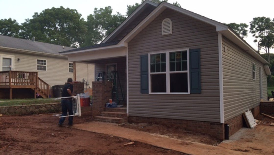 Habitat for humanity dedicates 4 new homes to local families for Local house builders