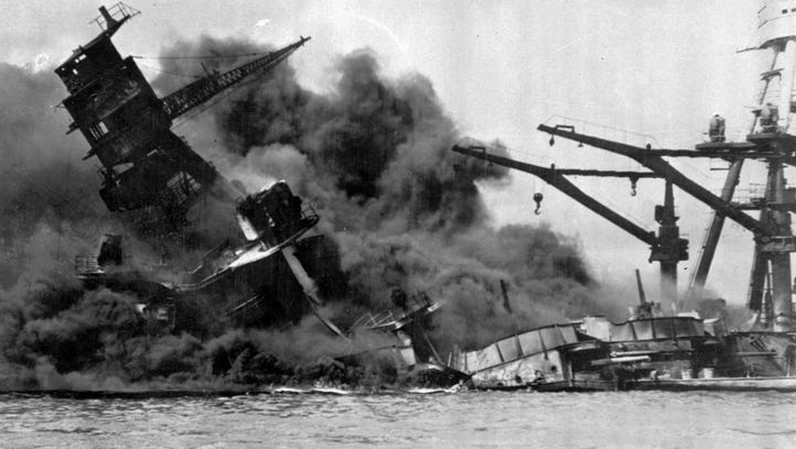 Smoke billows from the USS Arizona after the Japanese