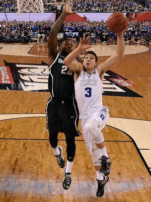Duke guard Grayson Allen (3) goes to the hoop against Michigan State  guard/forward Branden Dawson (22) during the first half Saturday in Indianapolis.