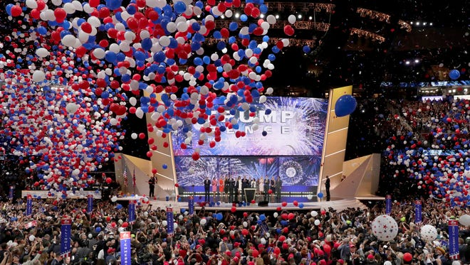 Republican Presidential Candidate Donald Trump, and Republican Vice Presidential Nominee Gov. Mike Pence of Indiana watch with their families as the balloons fall during the final day of the Republican National Convention in Cleveland, Thursday, July 21, 2016.
