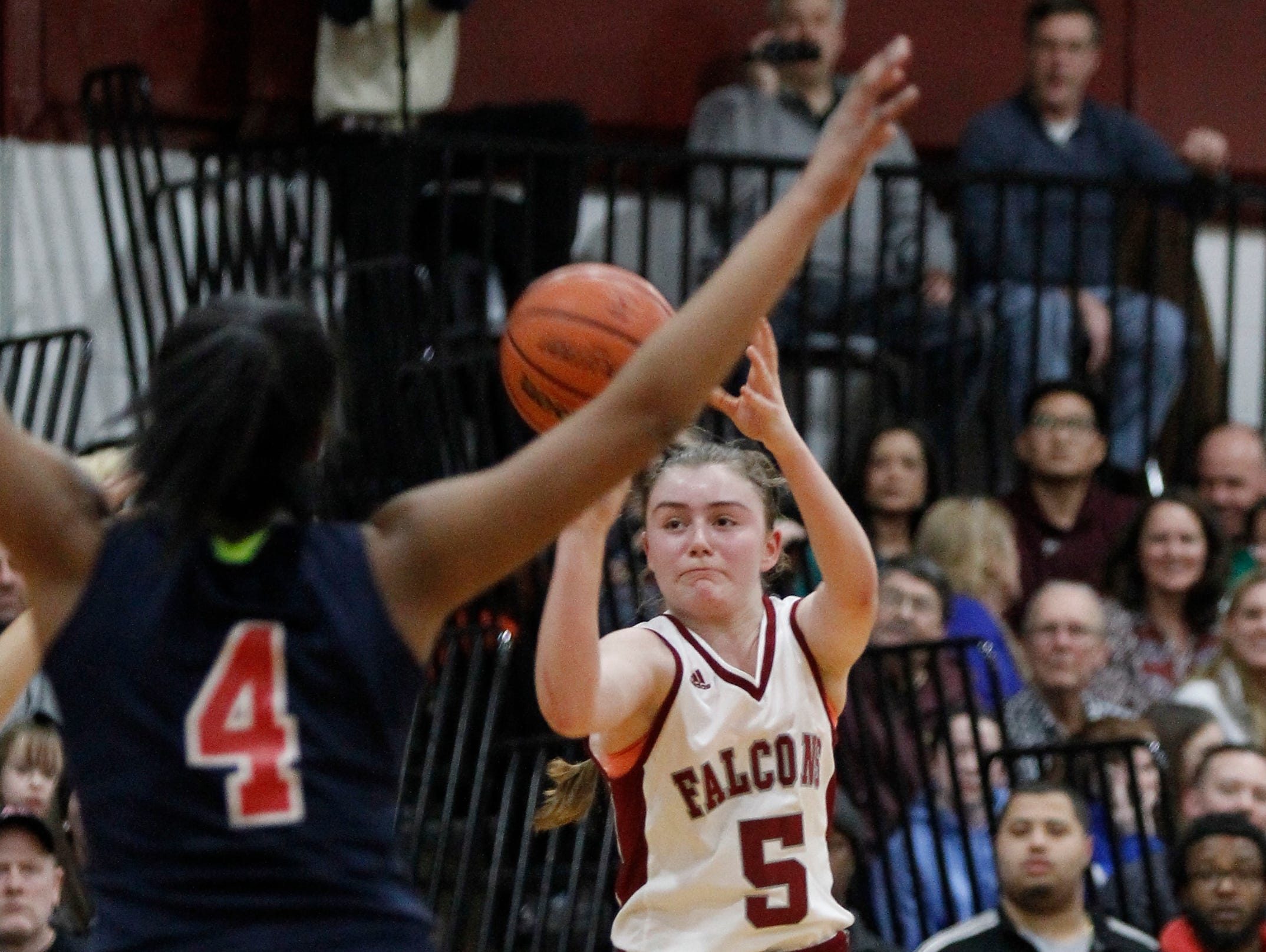 Albertus Magnus' Kate Mager takes an outside shot during the second half of the Falcons' victory over Peekskill in a Class A quarterfinal.