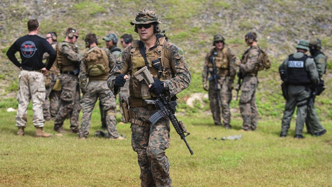 In this Feb. 7, 2017, file photo, officers of the Guam Police Department's Special Operations Division train alongside Marines from the 31st Marine Expeditionary Unit at the Naval Computer and Telecommunications Area Master Station in Finegayen, Dededo.