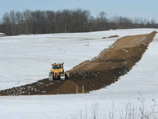 Seagulls forage freshly turned soil Wednesday afternoon as work continues on the Rover Pipeline in the area of Ohio 603 and 42.