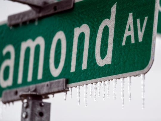 Icicles are seen on the street signs at the intersection of Diamond Avenue and S. Governor Street in Evansville on Wednesday.