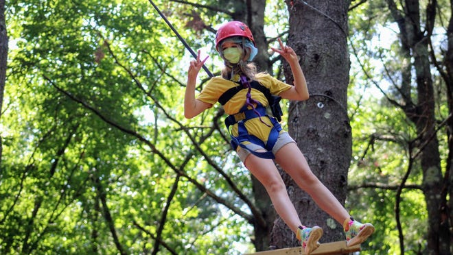 Instead of holding its usual 10-week program with its 100 staff members, Pilgrim Day Camp held several safe activities, including archery, blueberry picking, cook outs, pottery, drive-in movies and ziplining (seen above), for campers and their families throughout the summer.