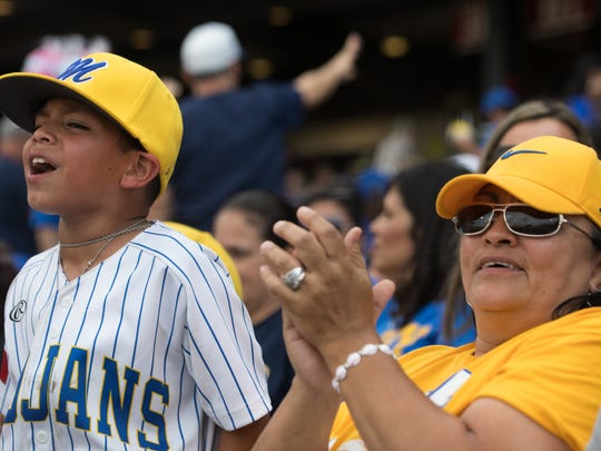 A Moody fan cheers from the stands during game two against King in the Class 5A regional quarterfinal baseball series at Whataburger Field on Friday, May 19, 2017.