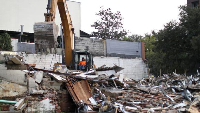 The Crowder Construction company works to demolish a building on the corner of Duval and Jefferson Streets downtown Wednesday, Sept. 20, 2017.