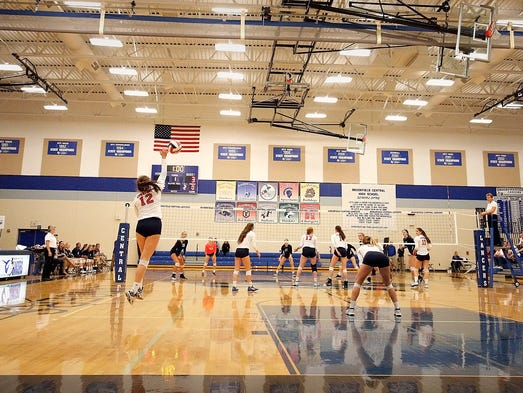 Brookfield East's Hannah Maney (12) leaps up to serve