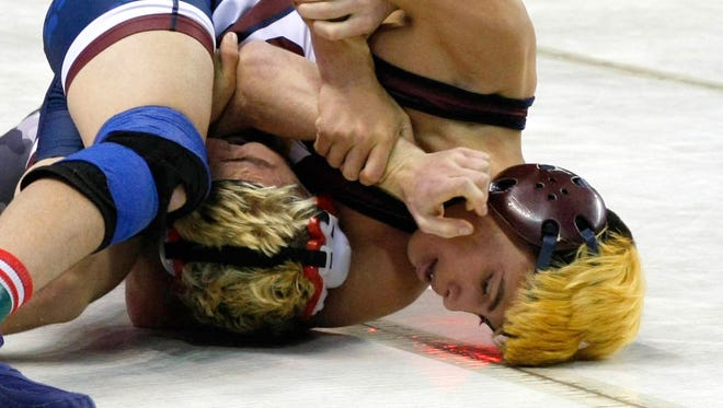 Freshman Jesse Daniel Perez (top) placed fifth at 126 pounds at the Class 5A State Wrestling Tournament Saturday in Rio Rancho.