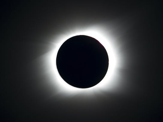 A total solar eclipse occurs when the moon gets in