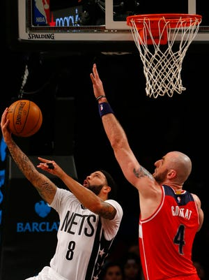 Brooklyn Nets guard Deron Williams (8) shoots the ball in front of Washington Wizards center Marcin Gortat (4) during first half at Barclays Center.