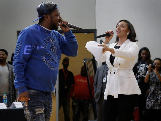 """Rapper K-Deezy is intorduced by Detroit City Councilwoman Mary Sheffield, who hosts the third annual """"State of the Youth"""" symposium to talk about the challenges and dangers Detroit kids face."""